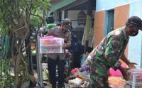 Banjir Kiriman Bromo Surut, Anggota TNI-Polri Bantu Rumah Warga yang Terdampak