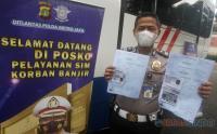 Ditlantas Polda Metro Jaya Beri Pelayanan SIM Keliling untuk Korban Banjir
