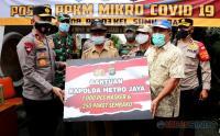Wakapolda Metro Jaya Serahkan Bantuan 1.000 Masker dan 250 Paket Sembako