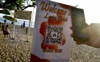 Wisata Kembali Dibuka, Pengunjung Pantai Legian Bali Wajib QR Code Aplikasi PeduliLindungi