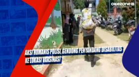 Aksi Humanis Polisi, Gendong Penyandang Disabilitas ke Lokasi Vaksinasi