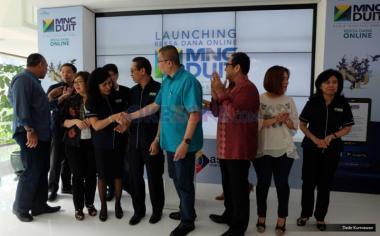 Suasana peluncuran MNC DUIT di lobby MNC Financial Center, Jakarta, Jumat (19/5/2017). Reksa dana online MNC DUIT hadir untuk menjadi solusi bagi keinginan masyarakat berinvestasi di era digital dengan kemudahan serta keamanan fitur-fitur yang diberikan. Fasilitas tersebut dapat diakses melalui www.mncduit.co.id atau juga dapat diunduh melalui perangkat Android di Google Play Store.