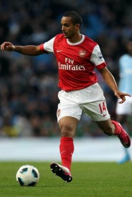 Aksi Theo Walcott saat laga Arsenal vs Manchester City