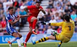 Pesepakbola Liverpool Danny Ings mencetak gol pertama ke gawang Wigan Athletic pada menit 70.