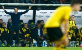 Pelatih Borussia Dortmund Thomas Tuchel memperlihatkan kekecewaan saat menyaksikan anak-anaknya bertanding melawan Bayern Munich.