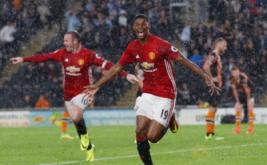 Marcus Rashford selebrasi usai mencetak gol ke gawang Hull City di injury time pada matchday ketiga Liga Inggris.
