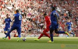 Selebrasi Roberto Firmino usai mencetak gol pertama ke gawang Leicester pada pertandingan Liverpool vs Leicester City di Stadion Anfield, Inggris, Sabtu (10/9/2016). Pada pertandingan tersebut tuan rumah berhasil menang telak 4-1 atas juara bertahan Leicester.