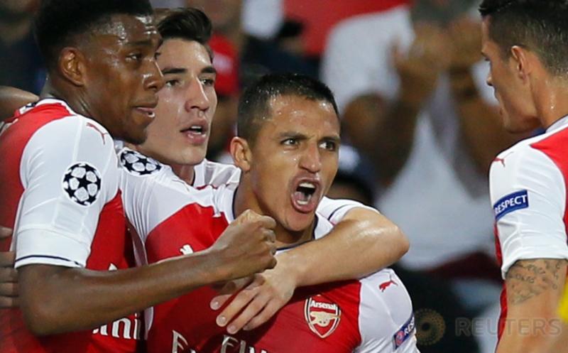 Alexis Sanchez selebrasi usai mencetak gol ke gawang Paris Saint-Germain pada matchday perdana Grup A Liga Champions 2016-2017 di Parc des Princes, Paris, Prancis, Rabu (14/9/2016) dini hari WIB.