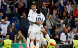 Alvaro Morata merayakan golnya bersama James Rodriguez pada laga matchday perdana Grup F Liga Champions 2016-2017 di Santiago Bernabeu, Madrid, Spanyol, Kamis (15/9/2016) dini hari WIB.