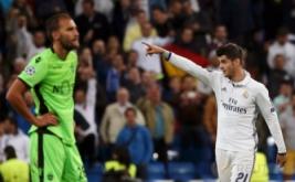 Alvaro Morata selebrasi usai mencetak gol ke gawang Sporting di menit 90+4 pada laga matchday perdana Grup F Liga Champions 2016-2017 di Santiago Bernabeu, Madrid, Spanyol, Kamis (15/9/2016) dini hari WIB.
