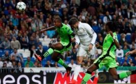 Alvaro Morata (tengah) mencetak gol ke gawang Sporting pada laga matchday perdana Grup F Liga Champions 2016-2017 di Santiago Bernabeu, Madrid, Spanyol, Kamis (15/9/2016) dini hari WIB.