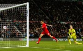 Philippe Coutinho mencetak gol ke gawang Derby Country.