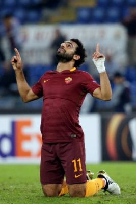 Mohamed Salah selebrasi usai mencetak gol ke gawang Astra pada laga lanjutan Europa League, di Stadio Olimpico, Jumat (30/9/2016) dini hari WIB.