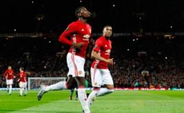 Paul Pogba (kiri) merayakan golnya ke gawang Fenerbahce pada babak penyisihan Grup A UEFA Liga Europa.