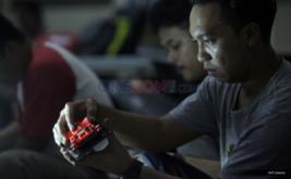 <p>  Ratusan racer Tamiya bertanding pada ajang RS Tamiya Grand Final STB+ (Standart Box Plus) Nasional Championship Tour 2016 di Mega Glodok Kemayoran, Jakarta, Jumat (11/11/2016).</p>