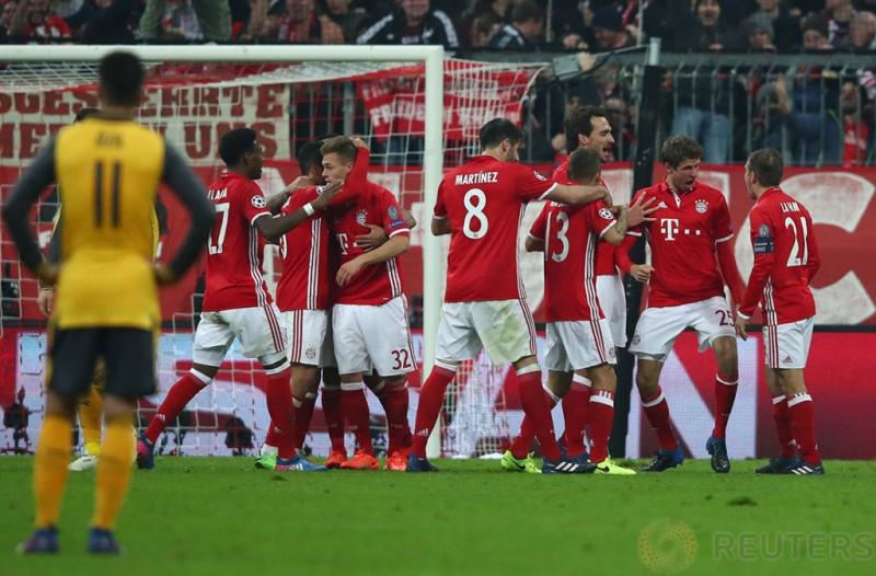 Thomas Muller saat melakukan selebrasi usai mencetak gol pada pertandingan 16 besar liga Champion Bayern Munchen vs Arsenal yang berakhir keunggulan Bayern Munchen 5-1. Reuters / Michael Dalder