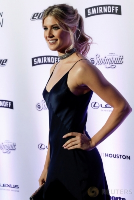"Petenis Eugenie Bouchard menghadiri acara peluncuran ""The Swimsuit Issue"" di New York, Amerika Serikat, Jumat (17/2/2017) WIB. Petenis wanita berkebangsaan Kanada ini semakin terlihat cantik dengan busana hitam yang dikenakannya. (REUTERS/Mike Segar)"