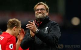 Pelatih Liverpool Jurgen Kloop sumringah ketika timnya mampu megalahkan West Bromwich Albion.