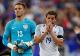 Adam Lallana terlihat muram usai pertandingan persahabatan Prancis vs Inggris di Stade de France, St Denis, Prancis, Rabu (14/6/2017) dini hari WIB. Anak asuh Didier Deschamps berhasil meraih kemenangan 3-2. Reuters / Lee Smith