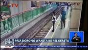 Pria Dorong Wanita ke Rel Kereta